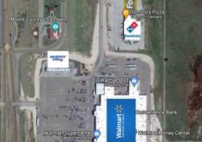 satellite image of walmart dominos and lot for sale